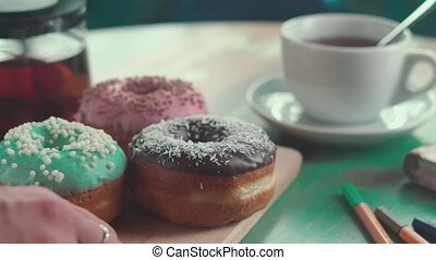 Colorful donuts icing on the air. Tea and donuts - Morning...