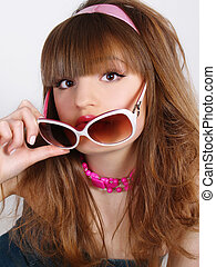 Portrait of the beautiful girl with solar glasses in a retro style on white background