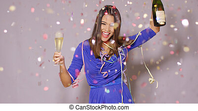 Giggling happy woman celebrating the New Year - Giggling...