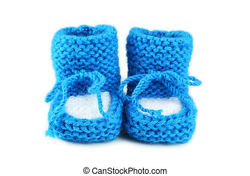 Handmade baby booties isolated on a white