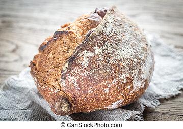 Wholegrain bread on the dark wooden background