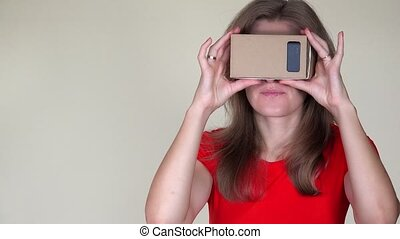 Emotional woman gets scared of view from virtual reality...
