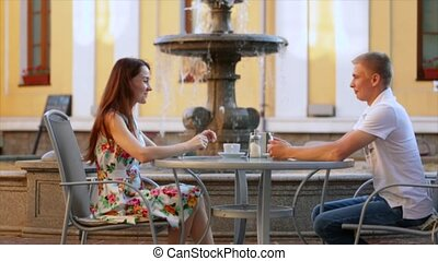 Young beautiful couple relaxing at the restaurant on the...