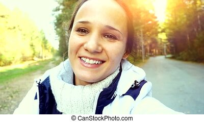 Young smiling woman driving ATV in the park. 3840x2160 -...