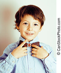 little cute boy in bowtie smiling, making funny faces, stylish casual kid, lifestyle people concept