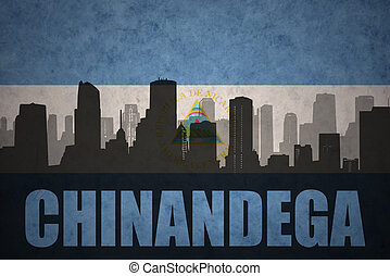 abstract silhouette of the city with text Chinandega at the...