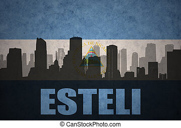 abstract silhouette of the city with text Esteli at the...
