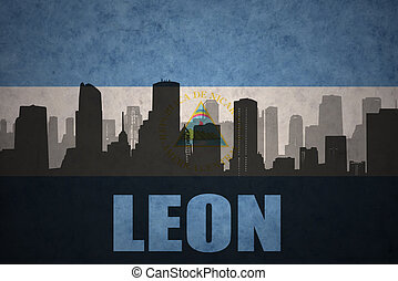 abstract silhouette of the city with text Leon at the...