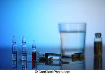 Syringe and ampoules - Syringe, ampoules and pills on...