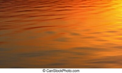 The sun is reflected in the waves of the sea during sunset...