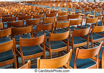 Many Empty Wooden Chairs With Backrest, Blue Upholstery...