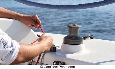 Incorrect use a winch on a yacht. Wrong rope laying