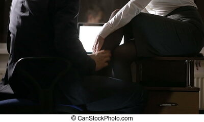 sexual relations at work. Young business couple are having...