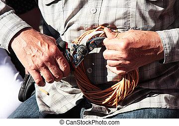 human hands braiding wicker