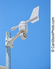 Weather Station Mounted on Pole - A white weather station...