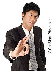 Young businessman give you a ok sign, closeup portrait of...