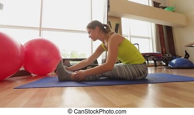 Sport, executes exercise beautiful girl in a bright room,...