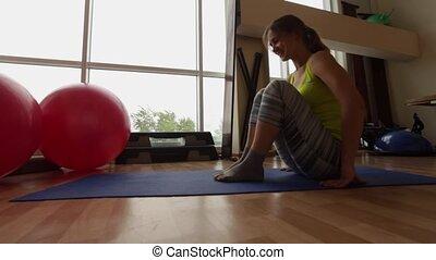 Sport, young girl performs posture Crane Bakasana. - Sport,...