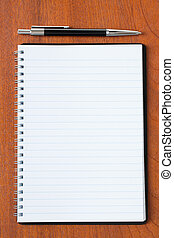 black pen and notebook - photo shot of black pen and...