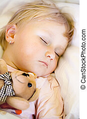 sleeping child with teddy bear - photo shot of sleeping...