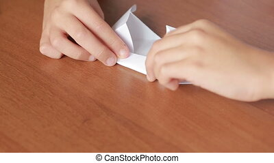Little boy drawing on paper art origami. hobby crafts