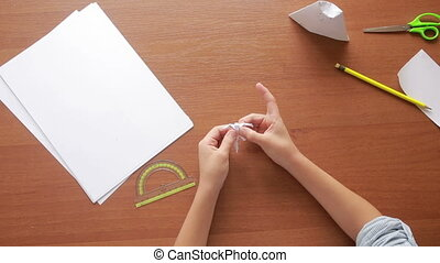 Little boy drawing on paper art origami. hobby crafts. top...