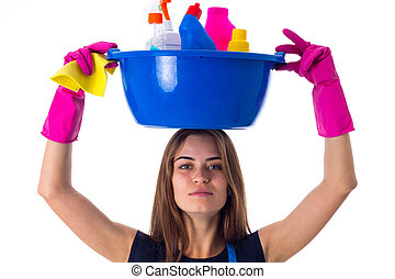 Woman holding cleaning things in washbowl - Young beautiful...