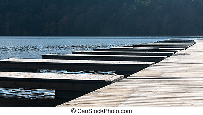 Empty boat docks and moorings after boats are removed -...