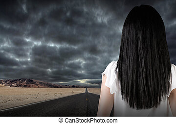 Businesswoman Looking Out a Dark Road - Businesswoman...