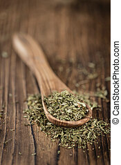 Old wooden table with dried Stevia leaves (selective focus)...