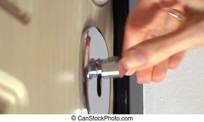 Woman closing the door and locking up several locks....