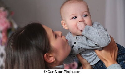 Mother holding sweet baby having fun