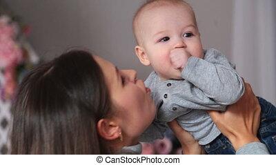 Mother holding sweet baby having fun