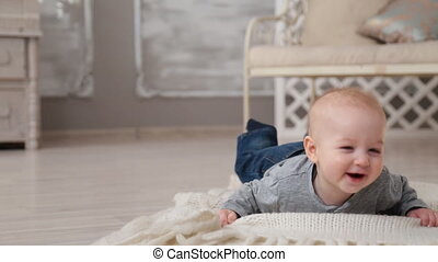 Happy smiling baby - adorable happy smiling baby lying