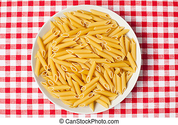 pasta in plate on picnic tablecloth