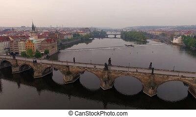 Flying over Charles Bridge in Prague, Czech Republic -...
