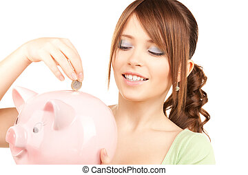 lovely teenage girl with piggy bank and coin - picture of...