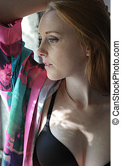 Red Haired Woman in Colorful Silk Robe and Black Bra - Photo...