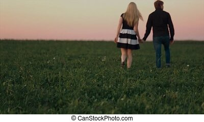Young beautiful sensual pair is in the sunset
