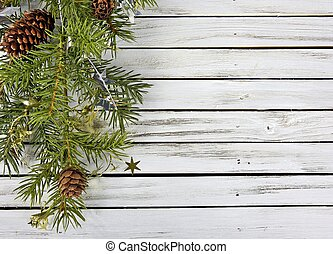 Christmas pine bough - pine bough on rustic gray wood with...