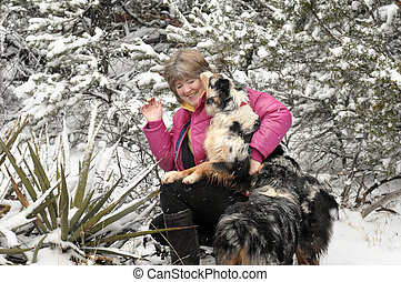 Exuberant Pet - Woman laughs as excited Australian Shepherd...