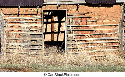 Crumbling Adobe - Background image shows empty doorway of...