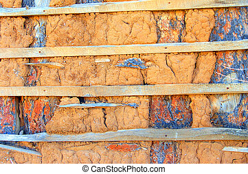 Adobe Wall Deteriorates - Deteriorating adobe home shows...