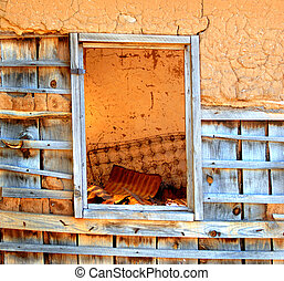 Abandoned Adobe - Window view shows inside of adobe home...