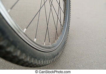 Mountain bike wheel photographed close-up against a...