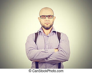 Serious bald man with arms crossed - Serious bald man with a...