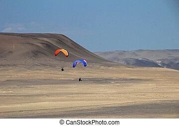 Paraglider over the cliffs of Paracas Peru - Paraglider...