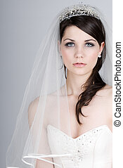 Beautiful Teenage Bride against Grey Background