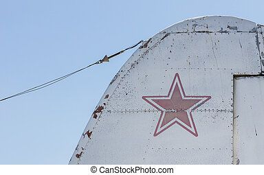 Star symbol on an old warplane, isolated