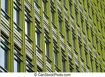 Office building with green frontage. - Green fronted office...